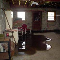 A flooded basement showing groundwater intrusion in Evansville