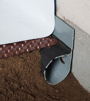 Closeup of a crawl space drainage system installed in Hardinsburg