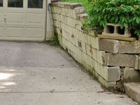 a failing retaining wall around a driveway in Evansville