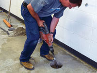 Coring the concrete of a concrete slab floor in Fort Knox