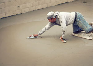 smoothing out the grout in a slab releveling project in Jasper