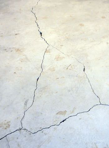severely cracked, heaving slab floors in a home in Petersburg