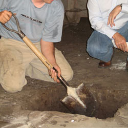 Digging a hole for the engineered fill used in a crawl space support system installation in Jasper