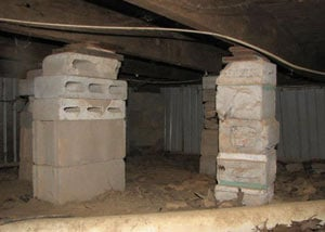 crawl space repairs done with concrete cinder blocks and wood shims in a Brandenburg home