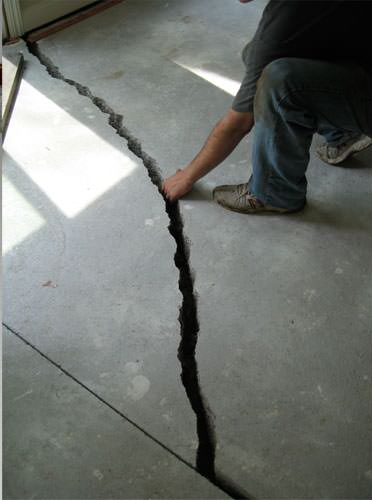 a severely damaged cracked concrete slab floor in Marion