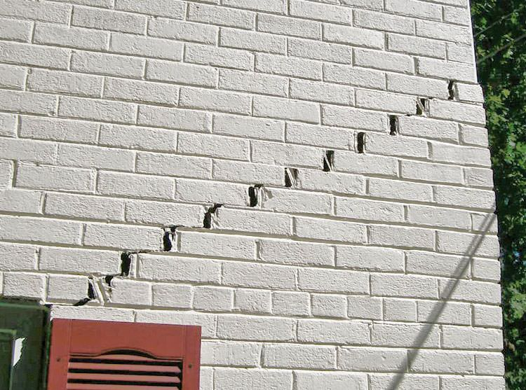 Stair-step cracks showing in a home foundation in Philpot