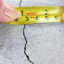 A crack in a poured concrete wall that's showing a normal crack during curing in Hartford