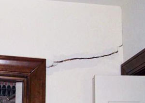 A large drywall crack in an interior wall in Vincennes