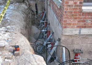 Foundation push piers installed around a house with a foundation settlement issues in Hardinsburg