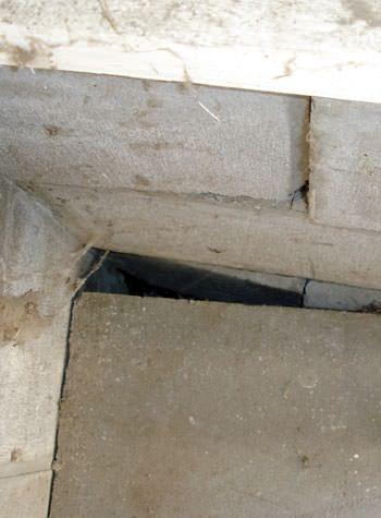 inward rotation of a foundation wall damaged by street creep in a garage in Philpot