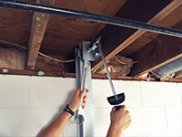 Straightening a foundation wall with the PowerBrace™ i-beam system in a Sheperdsville home.