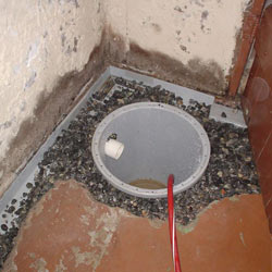 Installing a sump in a sump pump liner in a Radcliff home