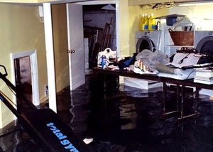 A laundry room flood in Spottsville, with several feet of water flooded in.