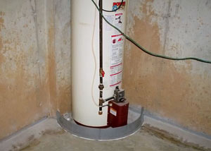 A water heater in Vine Grove that's been protected by the FloodRing® and a perimeter drain system.