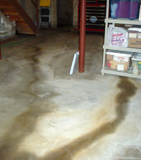 Flooding entering a basement through a floor crack in Huntingburg