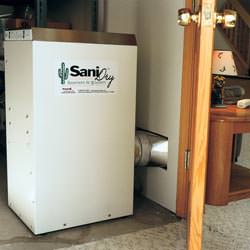 A basement dehumidifier with an ENERGY STAR® rating ducting dry air into a finished area of the basement  in Rockport