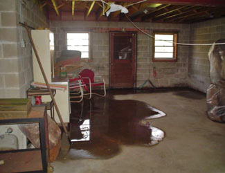 a flooded basement floor in a Rockport home