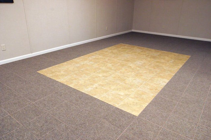 tiled and carpeted basement flooring installed in a Henderson home
